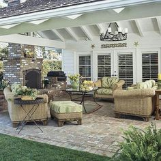 Very handsome and functional patio area.  Particularly like the peaked roof line, rather than the more typical flat roof over a patio, it make it feel far more spacious and gives it a greater connection to the interior of the home.  Nice outdoor fireplace and small built-in grilling area.