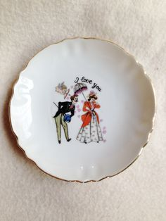 A personal favorite from my Etsy shop https://www.etsy.com/listing/216572667/small-tea-plate-i-love-you-scene-trimmed