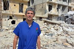 War surgeon David Nott reveals today how the Queen calmed him when he suffered a terrifying flashback at Buckingham Palace after returning from the Syrian conflict – with the aid of her corgis. David Nott, Syrian Civil War, Healthcare News, Doctor In, British Royals, Trauma, Aleppo, Mens Tops, Photo Pa