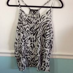 Papaya animal print sheer tank top NWOT Papaya tank top in sheer animal print fabric. Very pretty top. Please note the Back opens below the two buttons in back. It would lay nice under a jacket for fall. NWOT in excellent condition. Size  Large. Papaya Tops Tank Tops