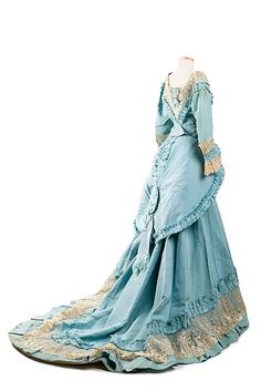 Sky blue silk faille dress, 1870s, designed and labeled by Mme. Gabrielle / Robes  Confections / 205 Rue St. Honoré in Paris. From the collections of the Charleston Museum