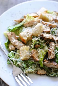 Classic Chicken Caesar Salad -- For an some more flavor, top with New York Style brand Garlic Bagel Crisps - The authentic taste of bagels from New York City bakeries. www.newyorkstyle.... #bagels #salads #caesar