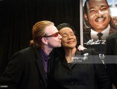 U2 singer Bono (L) kisses Coretta Scott King, widow of civil rights leader Martin Luther King Jr., during a news conference January 17, 2004 in Atlanta, Georgia. Bono was honored by the King Center during their annual Salute to Greatness awards dinner as a part of the 36th King Holiday Observance.