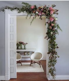 Asymmetrical pink and green doorway floral by Bows & Arrows