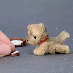This tiny Puppy is hand-crocheted from fantasy yarn and stuffed with non-allergic holofiber. Puppy will arrive to you packed in a gift-bag. Puppy is about 5 cm tall = 2 inches You can move his head, arms and legs. Very cute addition to your dollhouse and a nice gift for doll's and miniature's collectors or anyone who loves cute things.