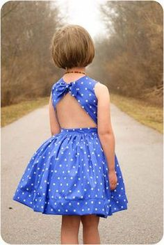 A classic and retro bodice meets a super fully skirt with a streamlined waistband that buttons at the back and has a unexpected modern open back with a quirky bow at the top. Sewing For Kids, Baby Sewing, Toddler Dress, Baby Dress, Little Girl Dresses, Girls Dresses, Dress Sewing Patterns, Sewing Clothes, Kids Wear