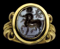 A ROMAN AGATE RING STONE   CIRCA 2ND CENTURY A.D.   The flat oval stone engraved with a Centaur shouldering a branch, on a short groundline; mounted as a ring in a modern gold setting  ½ in. (1.2 cm.) long; ring size 5½