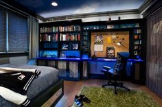 Teen Boy Bedrooms orange and blue Paint Ideas | Intimate teenage boy's bedroom with a dark color palette and ...