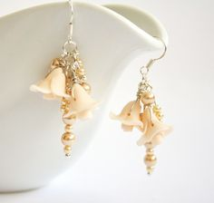 Ivory cluster earrings with tiny roses and Swarovski glass pearls, Polymer clay Israel jewelry Wedding earrings, bridal bridesmaids earrings. $40.00, via Etsy.