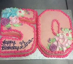 Number 50 cutout cake. Icing flowers.