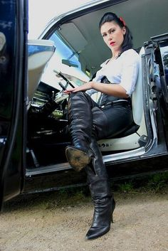Seated in car wearing black thigh boots