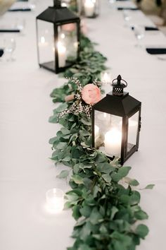 Black lanterns for winter wedding centerpieces and greenery table runner. - centerpieces lanterns Cool Black lanterns for winter wedding centerpieces and greenery table runner Winter Wedding Centerpieces, Lantern Centerpieces, Wedding Lanterns, Flower Centerpieces, Wedding Decorations, Table Decorations, Centerpiece Ideas, Black Centerpieces, Table Centerpiece Wedding