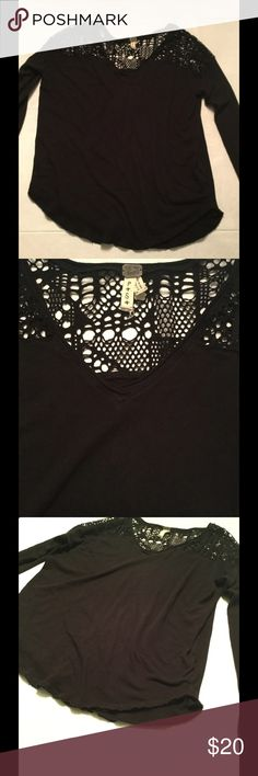 We the Free Long Sleeve Top Black long sleeve top with off center hem and crochet detail. Preowned. One flaw to note, tiny hole on back shown in last photo. Dime is for size reference. Free People Tops