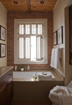 There are surprisingly few pins that offer decor ideas for dealing with an exposed red brick chimney in a bathroom. But I don't want a masculine bathroom! Ensuite Bathrooms, Bathroom Spa, Bathroom Renovations, Home Renovation, Master Bathroom, Bathroom Ideas, Big Bathtub, Bathtub Remodel, Dream Bath