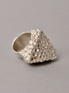 Young British Designers: Sterling Silver 'Honey Plasma' Ring by Imogen Belfield - Star clusters, bubbling gases, spiraling milky ways, and angular meteorites are all at the core of Imogen's collection. All of these influences are captured in the beautiful Honey Plasma Ring. Utterly incredible.