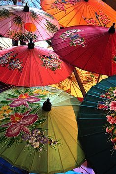 Visit the umbrella-making village in Chiang Mai, Thailand. We saw these umbrellas being made. favorite part in chiang mai...