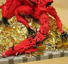 LEGO aficionado Fat Tony 1138 has custom built the dragon Smaug from The Hobbit by J. Tolkien out of LEGO elements and gold foil. Hobbit Dragon, Lego Dragon, Lego Boards, Desolation Of Smaug, Cool Lego Creations, Everything Is Awesome, Lego Brick, Tolkien, The Hobbit