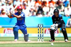 NAPIER, NEW ZEALAND - MARCH 08: Najibullah Zadran of Afghanistan bats during the 2015 ICC Cricket World Cup match between New Zealand and Afghanistan at McLean Park on March 8, 2015 in Napier, New Zealand.
