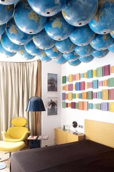 Who couldn't love this quirky ceiling, as seen on The Designer Pad? The whole house is full of neat details, but this room-sized collection of hanging globes definitely takes the cake.   - HouseBeautiful.com