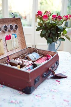 Re-use vintage suitcase for a pretty way to display/organize your sewing/craft/wrapping supplies...