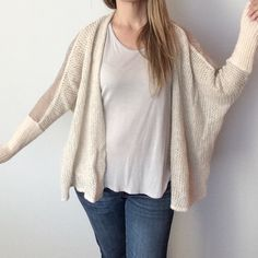 """Free People lace detail oversized cardigan Pre-owned, great condition, no holes or stains. This is a size small. Color is light pale pink, and lace is light pale gray. Made of 40% acrylic, 32% nylon, 18% wool, 10% alpaca. This is """"fuzzy"""" due to material. Lace detail 100% nylon. One hook closure. Measurements are hard to be exact bc of design. I wear a S/M & it is oversized and draped. Measurements: underarm to underarm flat across is approximately 32 inches. Back of neck to bottom of hem is…"""
