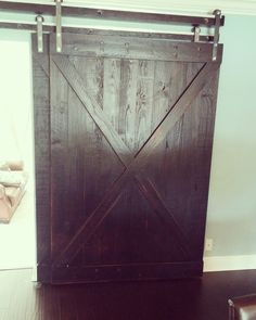 Made these overlapping solid wood barn doors with a dark stain and distressed.