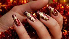 Uñas rojo y dorado