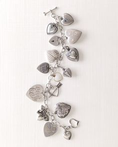 Heart Charm Bracelet... I 'need' this with the kiddos and hubby engraved on each heart and their pics in the locket