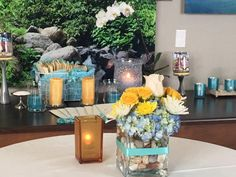 incorporate your loved ones favorite colors into flowers and decor.  Added seashells to the vases of flowers at a Beachy Celebration of Life Memorial www.eternallyloved.com