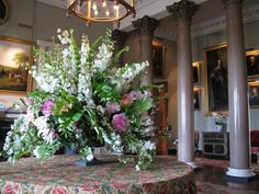 Front Hall table decorated with an urn filled with summer flowers by Matthew Spriggs