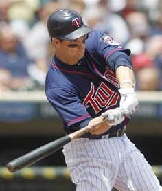 Minnesota Twins hitter Josh Willingham swings into a two-run home run off the Oakland Athletics pitcher Tyson Ross in the fifth inning of their baseball game Wednesday, May 30, 2012 in Minneapolis
