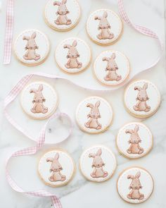 """An adorable bunny from a baby gir's birthday invitation hopped off the page and onto my cookies. This custom cookie order matches the """"some bunny is turning 1"""" invitations from an Etsy Shop called """"Designing for Peanuts"""". I couldn't wait to try and recreate the watercolor shadowing on the bunny. It's such a cute illustration and I loved making it come to life with icing.  _ #sweetkiera #skcookies"""