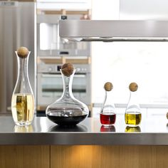 Scandinavian mouthblown glass carafe in the classic design features a solid oak stopper that fits perfectly on top and adds beauty to your bar or table!  Sagaform Wine Carafe with Oak Stopper.