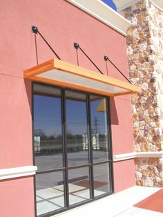 Over Head Supported Metal Awning