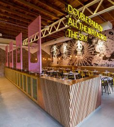 Modern Asian Restaurant Chi Chi in Sydney, designed by Matt Woods, Featured on Design Sponge, Warehouse, neon yellow black pink and natural wood accents, manga style