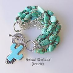 Schaef Designs white creek & royston turquoise & sterling silver 7 strand braclet with Rocki Gorman charm | Upscale online Southwestern, Equine, & Native American Jewelry Gallery Boutique | Schaef Designs artisan handcrafted Jewelry | San Diego CA  ($795.00)