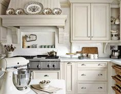 Off white cabinets white backsplash. Add texture in your kitchen for Fall with baskets and cutting boards, brown transferware completes the look Classic Kitchen, New Kitchen, Kitchen Decor, Kitchen Ideas, Cozy Kitchen, Kitchen White, Kitchen Mantle, Kitchen Colors, Kitchen Living
