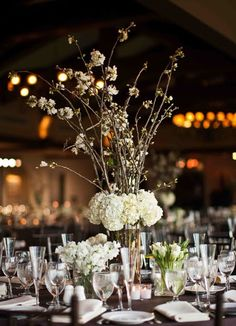 Tall cherry blossom and hydrangea arrangements anchored the centerpieces on the dinner tables...set at the base were 3 smaller monobotanical arrangements of green parrot tulips, white ranunculas, white sweet peas, green vibernum, helleborous, etc.