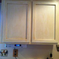 Antiquing kitchen cupboards.