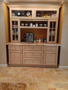 Coffee bar built with our Tuscany Kitchen Cabinets. They added the glass doors for accent and made a custom shelf. Small Cottage Kitchen, Farmhouse Style Kitchen, New Kitchen, Kitchen Ideas, Coffee Bars In Kitchen, Coffee Bar Home, Diy Bar, Tuscany Kitchen, Maple Kitchen Cabinets