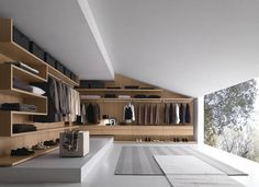 Closet and Wardrobe Designs. Modern luxurious open-space grey walk-in closet with stunning wall-mounted wooden wardrobe in cool design with nice grey carpet and beautiful outdoor view. Fancy Dream Home Interior Walk-in Closet Designs Walking Closet, Walk In Closet Design, Closet Designs, Dressing Design, Men Closet, Huge Closet, Walk In Wardrobe, Wooden Wardrobe, Bedroom Wardrobe