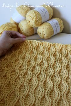 "This beautiful knit-look crocheted cable blanket is fun and easy to stitch. I've called it the ""cable tryst"" throw since the cables just meet-up, but never actually cross like they would in a traditional cable twist."