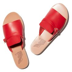As if these red leather slides weren't already perfect, the gold accent buckle and angular cutouts lend the classic style a little edge—they play equally...
