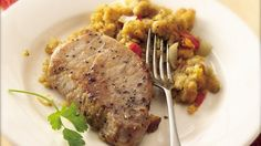 Corn bread stuffing is prepared alongside pork chops in a satisfying slow-cooked supper.