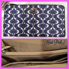 """Host Pick PEYTON MULTI FUNCTION WALLET PEYTON MULTIFUNCTION WALLET. Dream C print coated canvas with leather trim. 3 inside open pockets and six credit card pockets. Zipper coin pocket in middle. Outside pocket. Zip-top closure, fabric lining. Strap with clip to form a wrist strap or attach to the inside of a bag 10"""" (L) x 5"""" (H). Please note size! This is an XXL Wallet Coach Bags Wallets"""