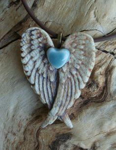 Robin's Egg Blue Winged Heart Porcelain Pendant 2 by muddyfingers
