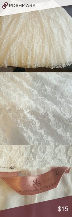 White lace skirt Soft white lace skirt, size large. Elastic waistband. NWT. This runs a bit small. Super cute lace overlay layer (see photos). Perfect for warmer weather! SJS Skirts Midi