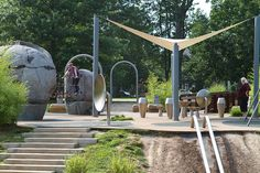 """The fancy playground in the park has been rated sixth best nationally by """"Child Magazine."""" The structures in the playground are designed to look naturalistic and include climbing boulders, dinosaur sand pit, swings, and slides."""
