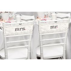 """Ivory satin chair sashes with ivory lace trim are embroidered in express with mr. and mrs. and punctuated with blush pink hearts. 8'10"""" (106"""") x 4"""", fits 16"""" chair back. The sashes tie into a bow to secure to the chair backs"""