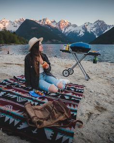 """Anybody else craving BBQs spent up in the mountains crushing vegan burgers while watching the sunset???  With the Napoleon TravelQ Series BBQ it was easy to zip on out to one of the most scenic areas in British Columbia and start grilling up!""  - @braybraywoowoo #NapoleonMoments  Featuring all-terrain wheels, easy folding, setup, and compact storage. Two burners provide precise heat for indirect grilling and smoking, or high heat searing!"